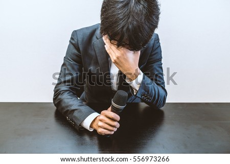 Depressed man holding the microphone