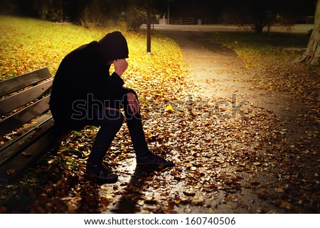Depressed Man On Bench - stock photo
