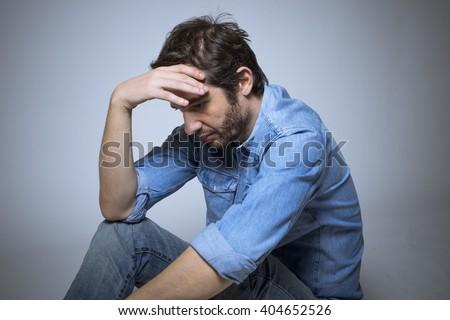 Depressed man studio shot - stock photo