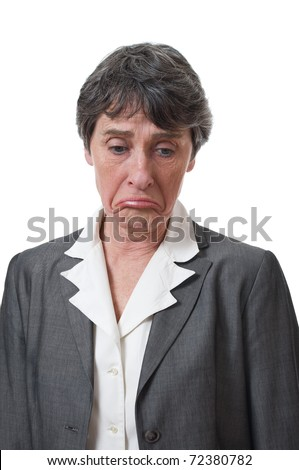 depressed mature businesswoman looking down isolated on white background - stock photo