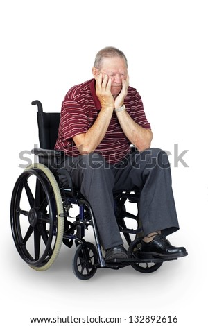 Depressed or sad senior old man in wheelchair