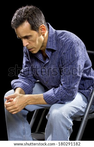 depressed or stressed man in black background - stock photo