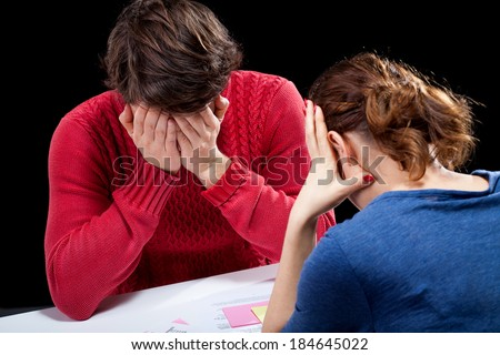 Depressed people in a hopeless financial situation - stock photo