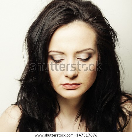 Depressed, sad woman - stock photo