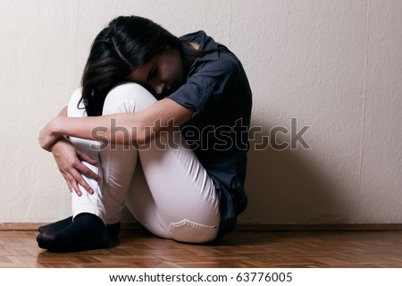 Depressed teenage girl cover the face . - stock photo
