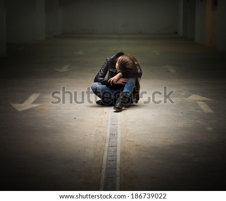 Depressed teenage girl with hands over face. - stock photo