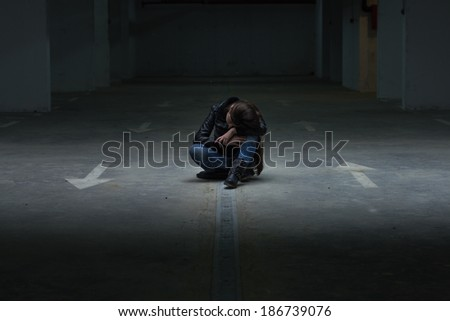 Depressed teenage girl with hands over face . - stock photo