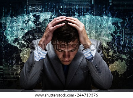 Depressed tired businessman with hands on head - stock photo