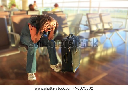 Depressed woman awaiting for plane with delay - stock photo