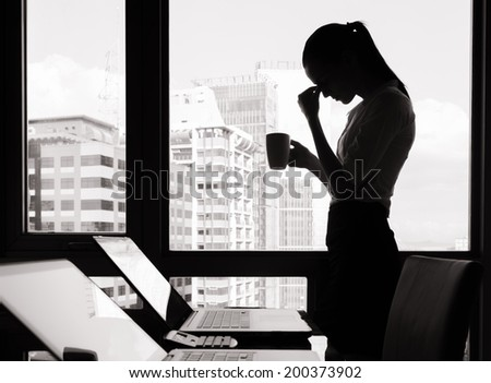 Depressed woman in the office. - stock photo