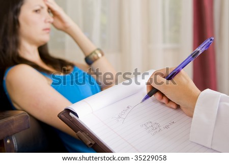 Depressed woman talking to her therapist - stock photo