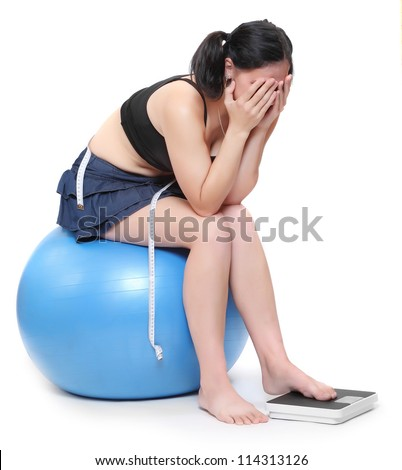 Depressed woman with measure tape. - stock photo