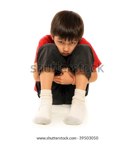 Depressed young boy over white background - stock photo