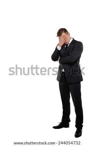 Depressed young business man holding his head. Crisis concept. - stock photo