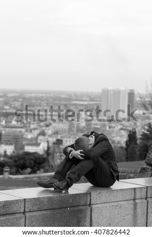 Depressed young businessman after losing his job - stock photo