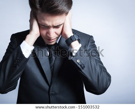 Depressed young man - stock photo