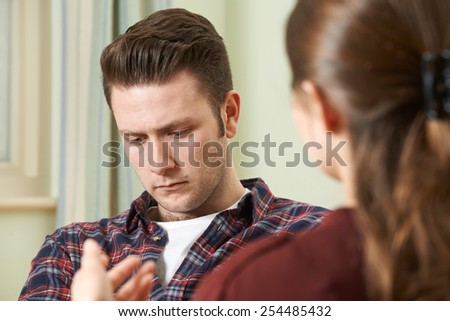 Depressed Young Man Talking To Counselor