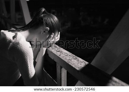 Depressed young woman outdoor - stock photo