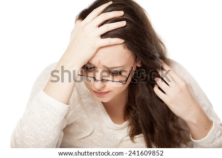 depressed young woman resting on her hand