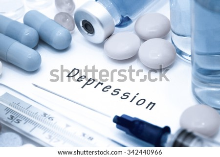 Depression - diagnosis written on a white piece of paper. Syringe and vaccine with drugs. - stock photo