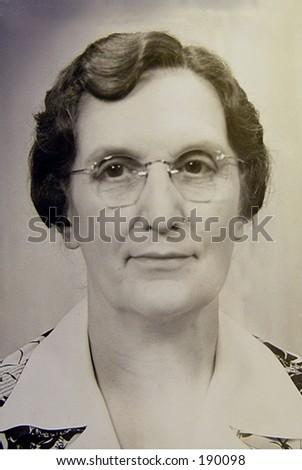 Depression era portrait of worn woman in glasses. - stock photo