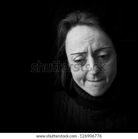 depression, woman frowning feeling pain with black background and copy space