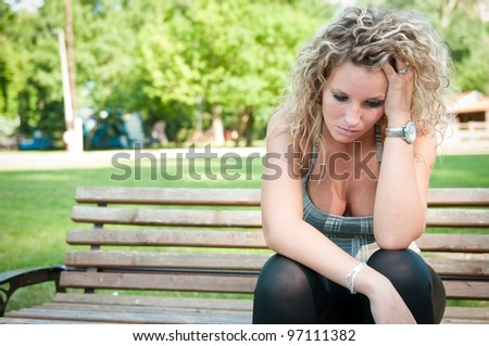 Depression - worried young woman - stock photo