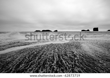 Depressive atmosphere - volcanic beach in cloudy weather, Iceland. - stock photo
