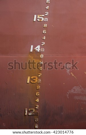 Depth markers on bulk ore carrier - stock photo