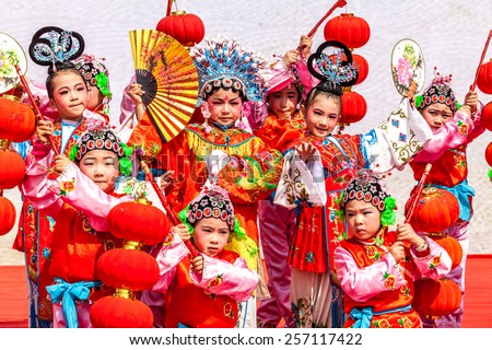 DEQING,CHINA - MAR 2: Dragon dance performances in Lantern Festival on March 2th 2015 in Deqing.Lantern Festival is a traditional festival of Chinese. - stock photo