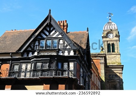 DERBY, UNITED KINGDOM - JULY 17, 2014 - The Royal Oak building (Formerly the Royal Oak Pub) and the Guild hall clock tower in the Market Place, Derby, Derbyshire, England, UK, July 17, 2014.