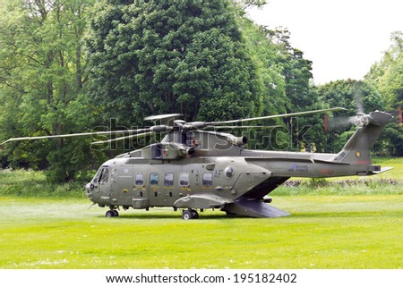 DERBYSHIRE, UK - JUNE 19, 2013: British Army helicopter landed in a countryside. - stock photo