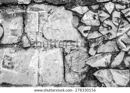 Derelict brick wall and old tiling in black and white - stock photo