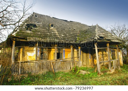 Derelict old rustic house - stock photo