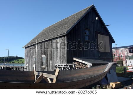 Derelict Wooden Building with Boat