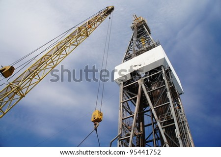 Derick of jack up drilling rig with the yellow rig crane - stock photo