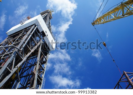 Derick of Offshore Jack Up Drilling Rig And A Rig Crane - stock photo