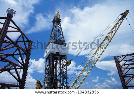 Derick of Offshore Jack Up Oil Drilling Rig And A Rig Crane