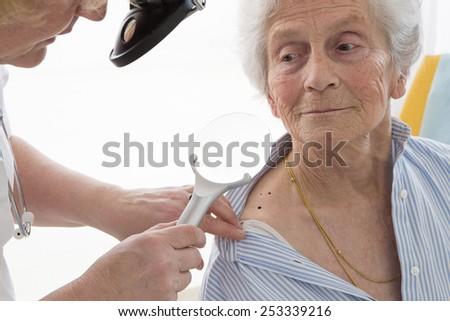 Dermatology Consultation senior Woman - stock photo