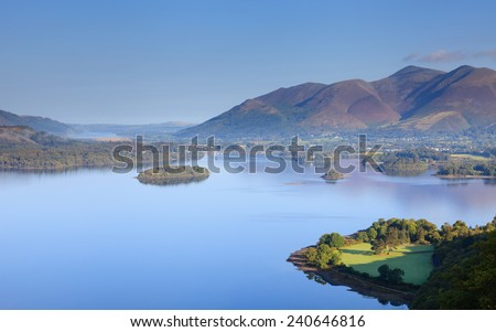 Derwentwater View.  A view across Derwentwater in the English Lake District national park to the town of Keswick and beyond is Skiddaw.  Skiddaw is the fourth highest mountain in England. - stock photo