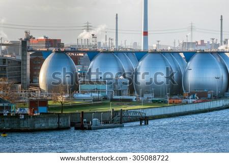 Desalination plant in hamburg harbor metallic eggs - stock photo