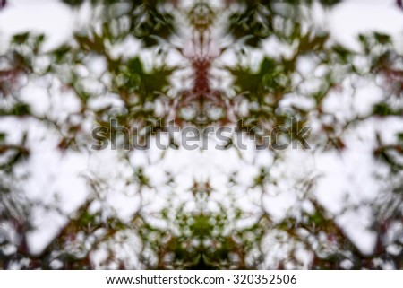 Desaturated red, green and white kaleidoscope pattern - stock photo