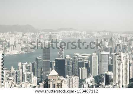 Desaturated view of Hong Kong from Victoria Peak. - stock photo