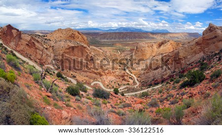 Descends steeply down the dirt road Burr Trail,  Capitol Reef National Park,  Utah - stock photo