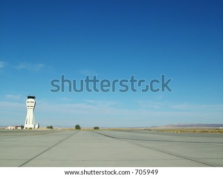 Desert Airport Runway and Tower - stock photo