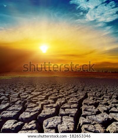 desert and orange sunset over it - stock photo