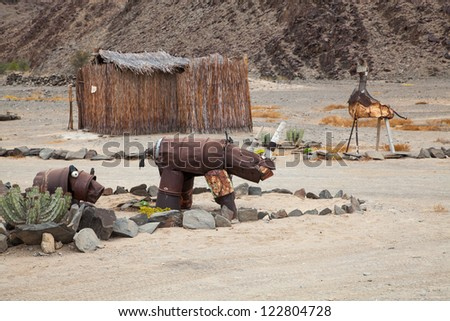 Desert art, Rhino sculpture in the desert. Desolation and beauty of Damaraland in Namibia.