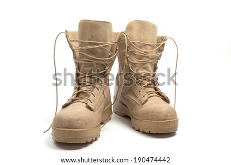 Desert brown canvas combat boots, isolated - stock photo