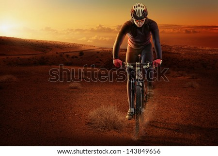 Desert cyclist - stock photo
