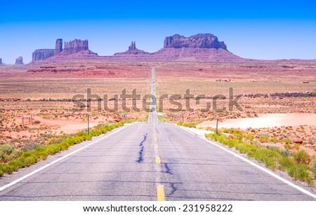 Desert highway leading into Monument Valley, Utah, USA - stock photo